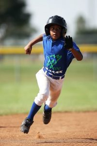 A boy running the bases