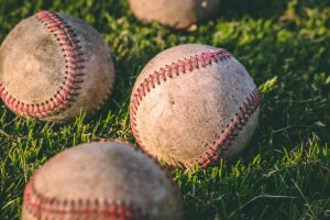 baseballs on a grassy field